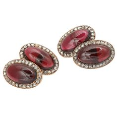 Exceptional pair of cabochon garnet cuff links set in 18kt gold framed in a border of rose cut diamonds. England, circa 1890