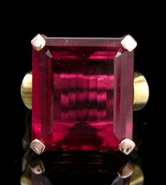 "A Cartier Emerald Cut Rubellite Ring In Rose And Yellow Gold, Ca. 1940's, A 14K yellow and rose gold ring set with a large emerald cut rubellite (. 16 ct). Shank marked 14k and ""Cartier."