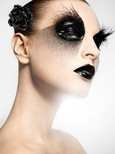 Oil-slick eyes, dramatic 'fall out', feathered brow, Black lips - Make-up