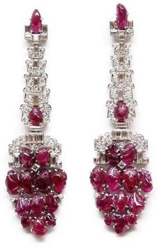 Pair of Art Deco diamond and carved ruby pendant earrings, c.1930 by nadine