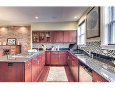 Plenty of counter space is accented by the cherry wood cabinets and floors