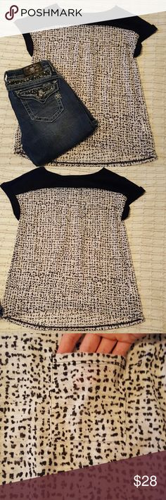 Calvin Klein Top Cute black and khaki colored Calvin Klein Top with spot detail. Pocket on left breast as shown in picture. Only worn twice. Like new! Calvin Klein Jeans Tops