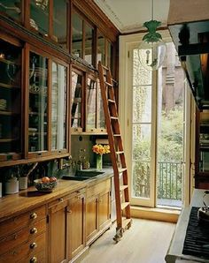 Tall cabinets can be tough to reach, but a vintage library ladder makes the job easier, and looks great too!