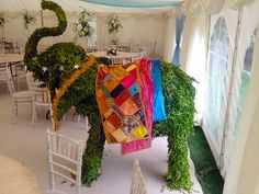 Yep, it's an elephant in a marquee. Doesn't it look great? It's a topiary elephant in fact for a May wedding in Oxford, England.