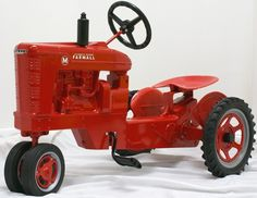 Pedal Tractor. Definitely in red not green :)