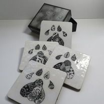 Hand made set of 4 coatsers. Each design is a hand drawn original. Comes in box as shown.  A £2 donation will be made to the WWF when you purchase this item.