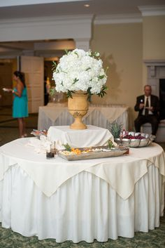Hoover Country Club weddings. summer wedding. living room buffet tables. white linens, white hydrangeas. simple reception. Birmingham, Alabama