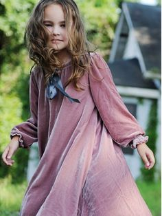"""simply delightful.. juney's dusty rose silk velvet dress has plenty of twirl, long sleeves with smocking and  grey satin ribbon at the neckline.  the perfect all occasion dress.sizes: S 3/4 , M 5/6 , L 7/827"""" 69 cm shoulder to hem  med 5/6Allow 2 weeks for delivery.Care instructions:  dry clean only"""