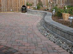 Interlocking stone patio and retaining wall