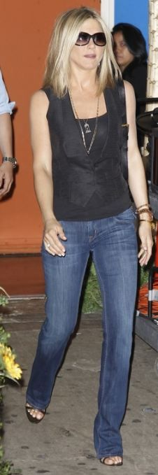Who made Jennifer Aniston's black sandals, blue jeans, gold watch, and leather handbag that she wore in New York on June 27, 2011?