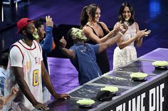NFL football player Emmanuel Sanders celebrates after winning the Key Slime Pie Eating competition during the 2016 Kid's Choice Sports Awards