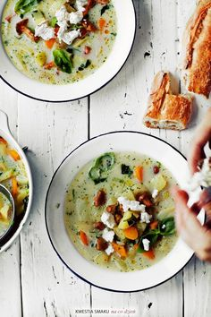 Light veggie soup topped with goat cheese