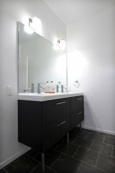 The new bathroom of the remodeled Phi Kappa Sigma fraternity house at USC includes vanities from Ikea.    Photo gallery