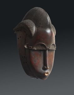 Africa | Baule people, Ivory Coast | Mask | Late 19th century | Wood, metal and kaolin | H. : 33 cm