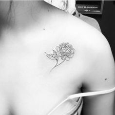 Peony tattoo on the chest.