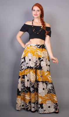 60s wide leg palazzo pants. high fitted waist with dramatic flared legs that look like a maxi skirt. asian inspired floral print cotton. hidden back zipper. lilli diamond label.