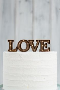 Marquee Letter Cake Topper | Grain and Co. | See More! http://heyweddinglady.com/secrets-of-event-lighting-theres-no-such-thing-as-too-many-chandeliers/