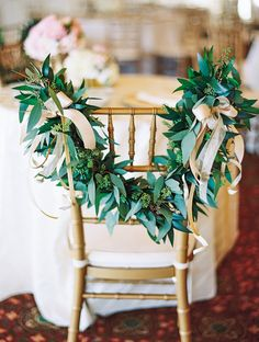 Chair Garland Decor | See the wedding on SMP: http://www.StyleMePretty.com/southeast-weddings/2014/02/06/romantic-wedding-in-historic-st-augustine/ Jennifer Blair Photography