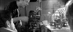 """Nick Park, behind the camera, shoots one of the miniature set-ups for his """"Wallace & Gromit"""" animations."""