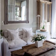 French linen, distressed wood & country chic in this stunning bedroom in Provence... #france #provence #hgtv #linen #fabrics #frenchlinen #rusticstyle #rustic #distressedtimber #mirror #chic #reclaimedtimber #reflections #light #french #cushions #decor #uniquefabrics #tulips #flowers #bestdesign #bestinteriors #sun #happymonday #traveltofrance #travel #decorating #inspiration