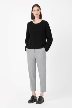 A loose, oversized fit with dropped shoulder seams, this jumper is made from wool with a tactile ripple effect. Slightly cropped for a relaxed shape, it a round neckline, straight long sleeves and narrow ribbed edges.