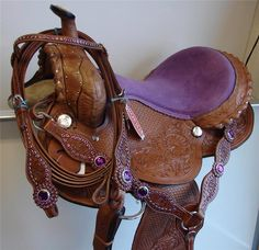 Brown leather with purple seating SHOWMAN saddle. Love the purple gems in the bridle and breast collar.