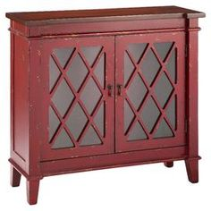 """2-door cabinet with latticed overlay and a hand-painted red finish.  Product: CabinetConstruction Material: MDFColor: RedFeatures:  Two doorsHand-paintedDimensions: 34.5"""" H x 35.5"""" W x 12.5"""" DCleaning and Care: Clean with a damp cloth"""