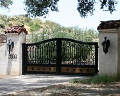 1st choice. Like wrought iron design. Make wood lighter in colour. Add design to too of gate. How look in white?