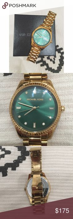 Michael Kors Forrest Green and Gold Slim Watch Beautiful dark green face with diamond like crystals accenting the numbers. Light wear with normal scratches. I will give you a box with this, but I don't have the links any more. Good for a small wrist. Such a beautiful watch for the fall and winter. Also needs a new battery Michael Kors Accessories Watches