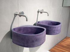 Wall-mounted cement washbasin, design by Gabriella Ciaschi (2013)