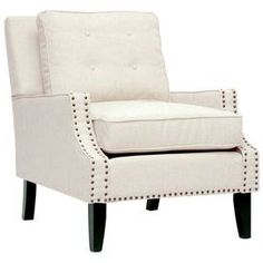 """Arm chair with a wood frame and nailhead trim.       Product: Chair    Construction Material: Linen blend, wood and foam cushioning    Color: Beige and black   Features:  Nailhead trim    Removable seat cushions     Dimensions: 35"""" H x 29"""" W x 35"""" D"""