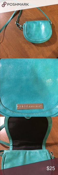 "BCBG sm. turquoise crossbody Cute little crossbody 6""X 7""  has 1 zipper compartment inside and magnetic closure on front. Adjustable strap. In new condition. BCBG Bags Crossbody Bags"