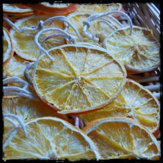 Dehydrated orange sun wheel ornaments for the Winter Solstice.