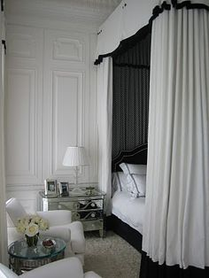 I love mirrored side tables.  Anything bigger than that would be too much.  I love the bedding, the curtains, and the white chairs in this bedroom.