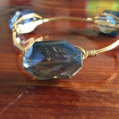 Bourbon and bow ties inspired bangle Blue, glass faceted stones on file wire. Size small Jewelry Bracelets