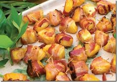 bacon_wrapped_pineapple_bites http://tastykitchen.com/recipes/appetizers-and-snacks/bacon-wrapped-pineapple-bites/