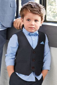 Page Boy With Blue Shirt Navy Waistcoat And Cute Little Bow Tie