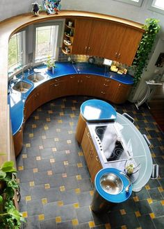 """I'm not a fan of contemporary styled interior design. but I will not lie when I say.this is s cool kichen. """"A colorful and curvaceous contemporary kitchen"""" Yurt Interior, Interior Styling, Interior Design, Round House Plans, Yurt Living, Silo House, Round Kitchen, Kitchen Floor, Dome House"""