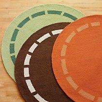 orange, brown, green boy's room rugs