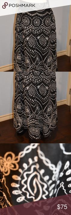 """Black linen skirt w/embroidered sz 12 Side zip. Like new. This gorgeous black flowing linen skirt is fully lined and has white embroidered work all over it. Side zipper. Waist 17"""" length 34"""". Exquisite piece!! Skirts"""