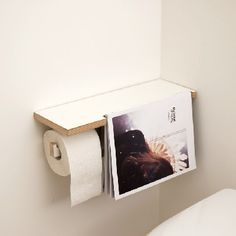 Beautiful toilet paper storage/magazine holder.