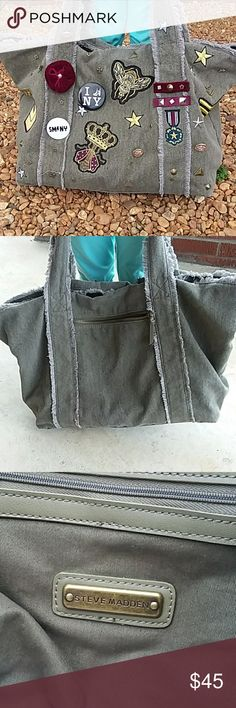 💣Patchwork Handbag BNWT Madden bag with one outside pocket, 2 inside pockets and then water bottle or cell phone pocket. A kick ass olive interior so things CAN BE FOUND!! (NO DIGGIN' IN A BLACK HOLE HERE!!!!) Tons of patches and buttons with a snap closure. This bag comes from a pet free and smoke-free home. Measurements pictured above. Steve Madden Bags Satchels