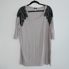 """Oversized shirt dress with shoulder detail Gray oversized shirt dress worn off the shoulder. Detailed with appliqué lace and sequins. Highly coveted piece. In great condition. Size small, 32"""" in length. No trades, no PayPal, no exceptions. Bundle for discount! H&M Dresses"""