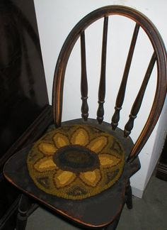 PrimiTive Folkart HooKed Rug SunFlower From  Beacon Hill Collectibles Primitive Sunflower Rug. $139.00, via Etsy.