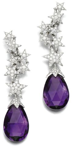 Amethyst and diamond earrings by Margherita Burgener. Each earring is boasts a surmount composed of a series of star motifs of various sizes, pavé-set with brilliant-cut diamonds. Each surmount suspends a faceted amethyst drop with a brilliant-cut diamond set cap. Via Diamonds in the Library.