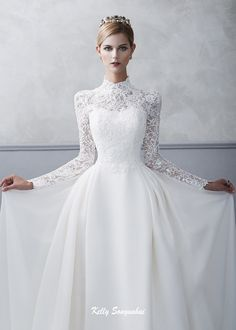 Royal wedding bridal dress with high neckline and sleeves decorated with c . Kraliyet düğün gelinlik yüksek yaka ve c ile dekore edilmiş kollu görünü… Royal wedding bridal dress with high neckline and sleeves decorated with c … Wedding Dress Sleeves, Long Sleeve Wedding, Modest Wedding Dresses, Wedding Dress Styles, Bridal Dresses, Lace Wedding, Royal Wedding Gowns, Dress Wedding, Bridal Gown Styles