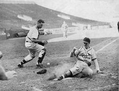 News Photo : St. Louis Cardinals outfielder Stan Musial slides...