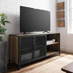 Welwick Designs 48 in. Dark Walnut Composite Corner TV Stand Fits TVs Up to 52 in. with Storage Doors HD8188 - The Home Depot Industrial Tv Unit, Industrial Style, Industrial Metal, Metal Furniture, Home Furniture, Metal Tv Stand, Black Tv Stand, Wood Tv Unit, Tv Stand Plans