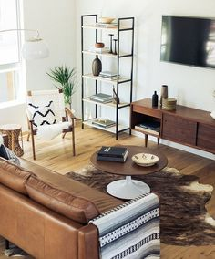 Living space inspiration / leather couch, cow hide rug, mid century inspired furniture, Mexican blanket