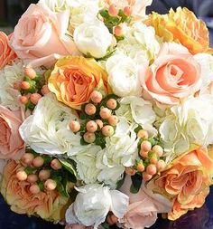 peach wedding flowers -use coral roses instead of the light pink